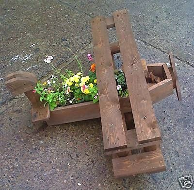 Wooden airplane planter teri for the air force family for How to make plant pots from pallets
