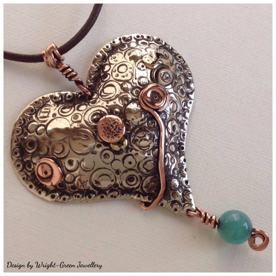 Silver and copper heart design pendant