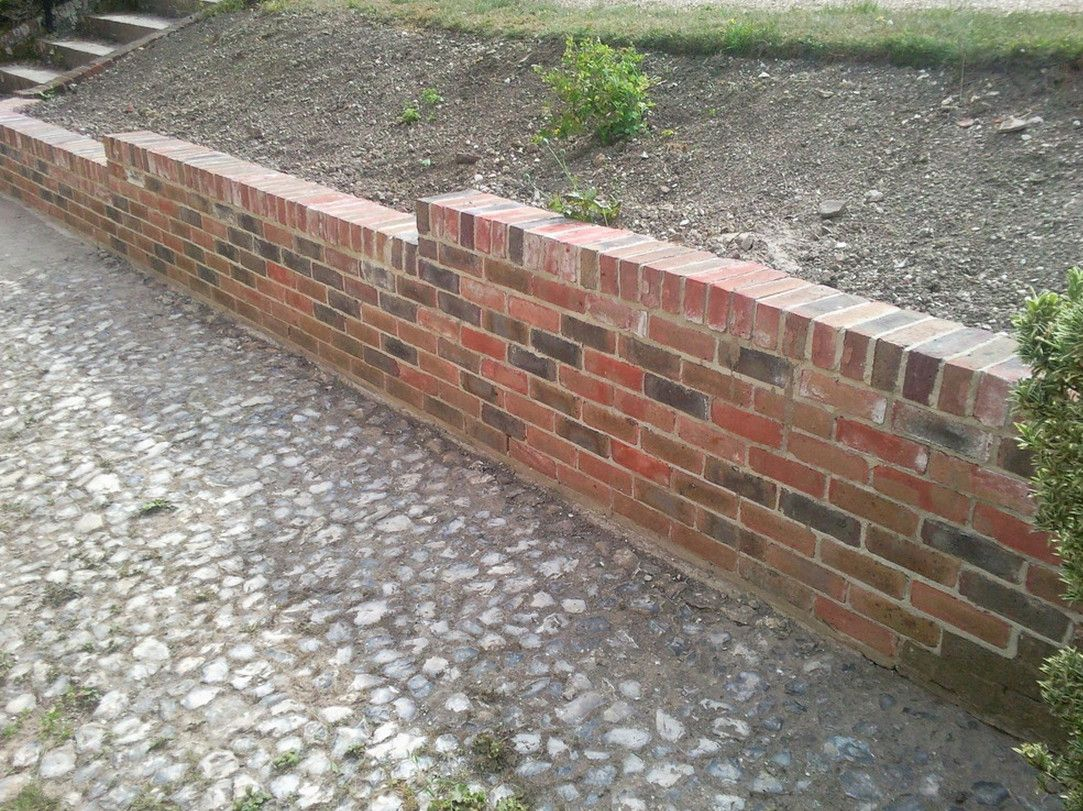 Brick Retaining Wall With Header Course Brick Wall Gardens