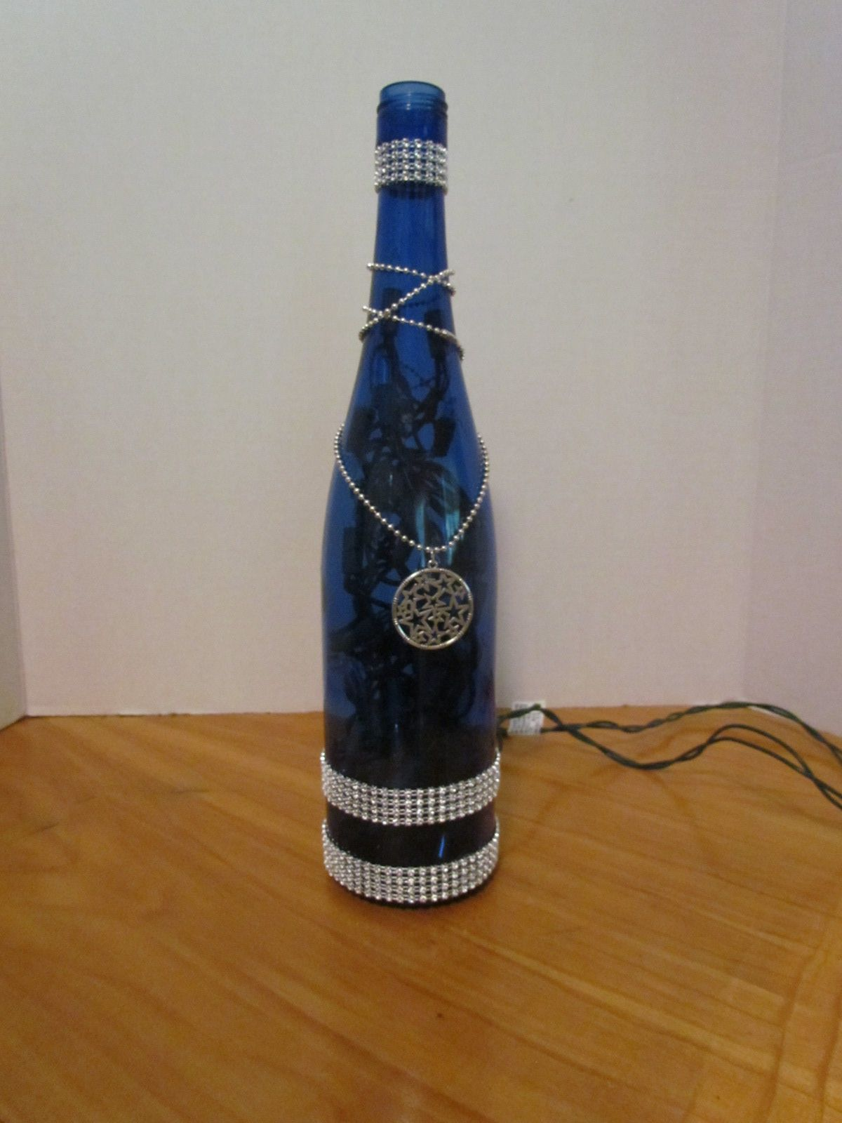 Blinged, Lighted Blue Wine Bottle with chain and charm.