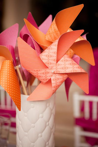 Pinwheels make bright and family-friendly centerpieces for a summer vow renewal. These are a great DIY project!
