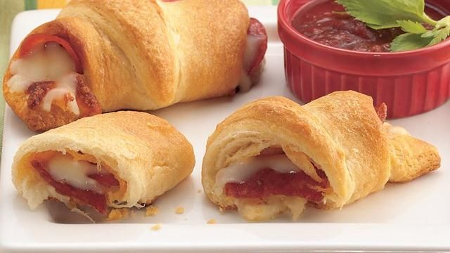 Pepperoni 'n Cheese Crescents    INGREDIENTS  1   (8-oz.) can Pillsbury® Refrigerated Crescent Dinner Rolls  24   slices (about 5 oz.) pepperoni  2   oz. (1/2 cup) shredded mozzarella cheese  1   cup tomato pasta or pizza sauce, heated