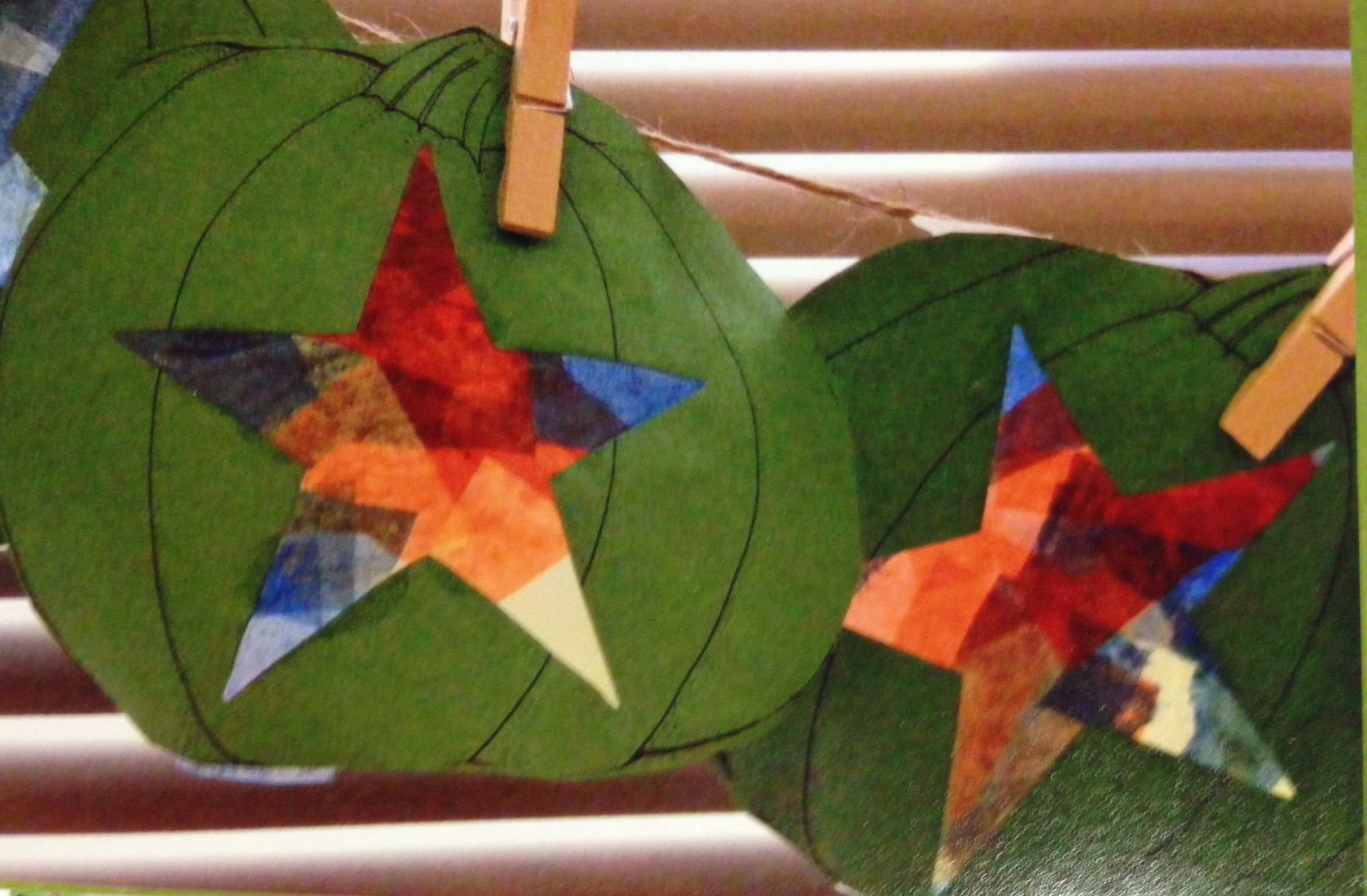 Green construction paper, star cut out, and colored tissue paper glued to the back. Put it in a window and let your light shine.