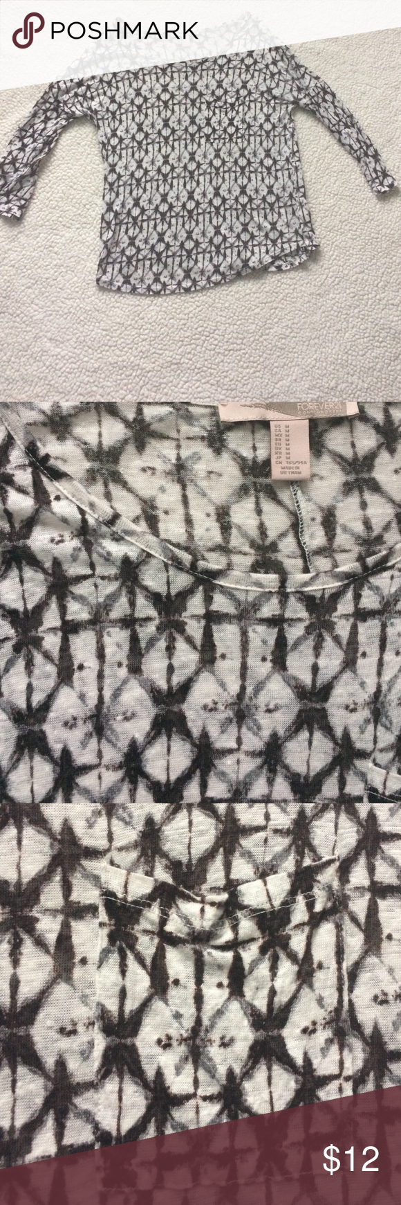 Forever 21 Tribal Top Cute lightweight 3/4 sleeve top. Pocket on top left, EUC! Love this top just never get a chance to wear it! Forever 21 Tops Blouses
