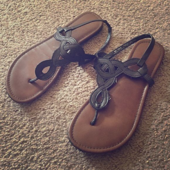 Brown Strappy Flats Firm on the price because I'm in no hurry to sell these! They're size 6, and from Faded Glory. Some light fraying from the Strappy area. Non adjustable straps. Faded Glory Shoes Flats & Loafers