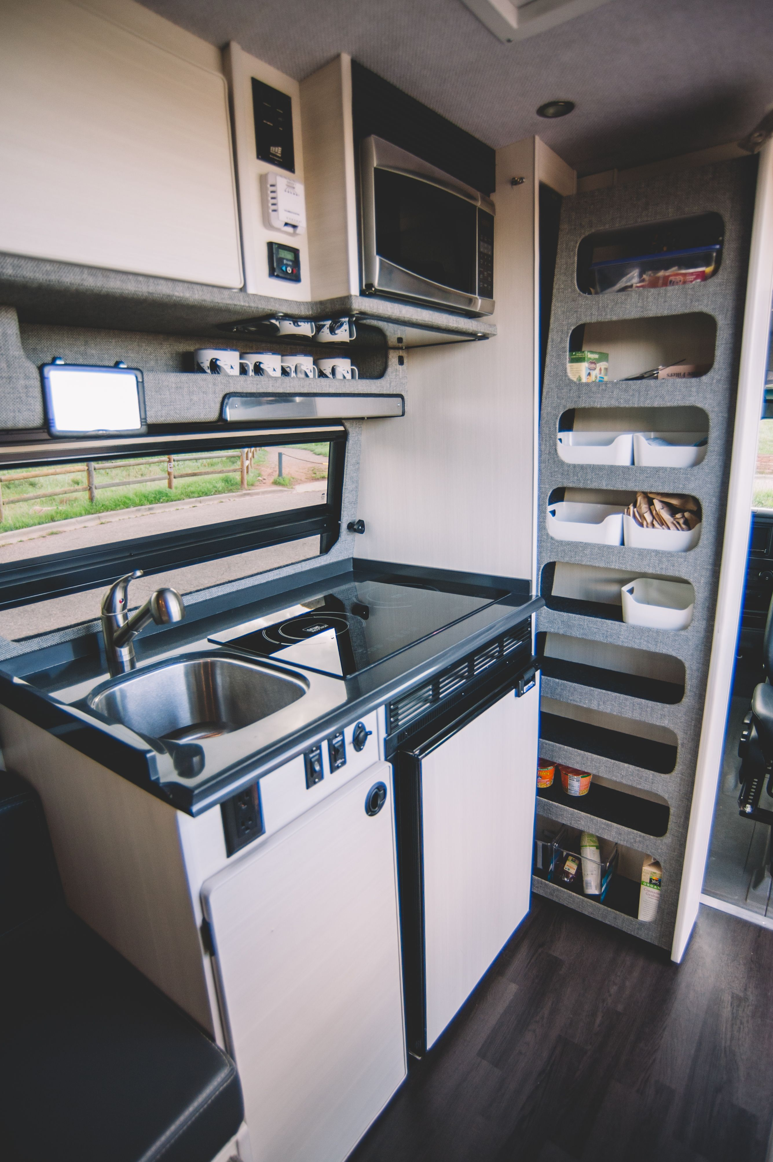 This Custom Camper Van Can Sleep A Family Of 6 Custom Camper Vans Camper Kitchen Camper Interior