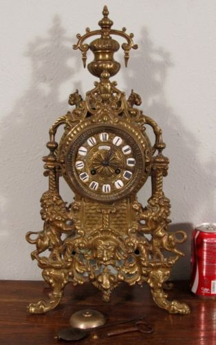 French Gothic bronze mantel clock.