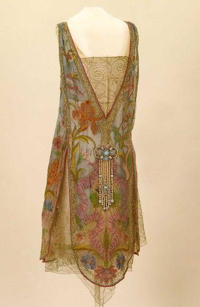 Callot Soeurs, Designer (French) ca.1926. Irises and water avens adorn this…