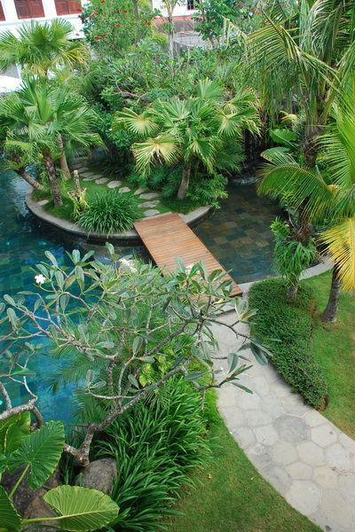 Tropical landscape design at Villa Batavia, Bali by Bali Landscape Company #bali…