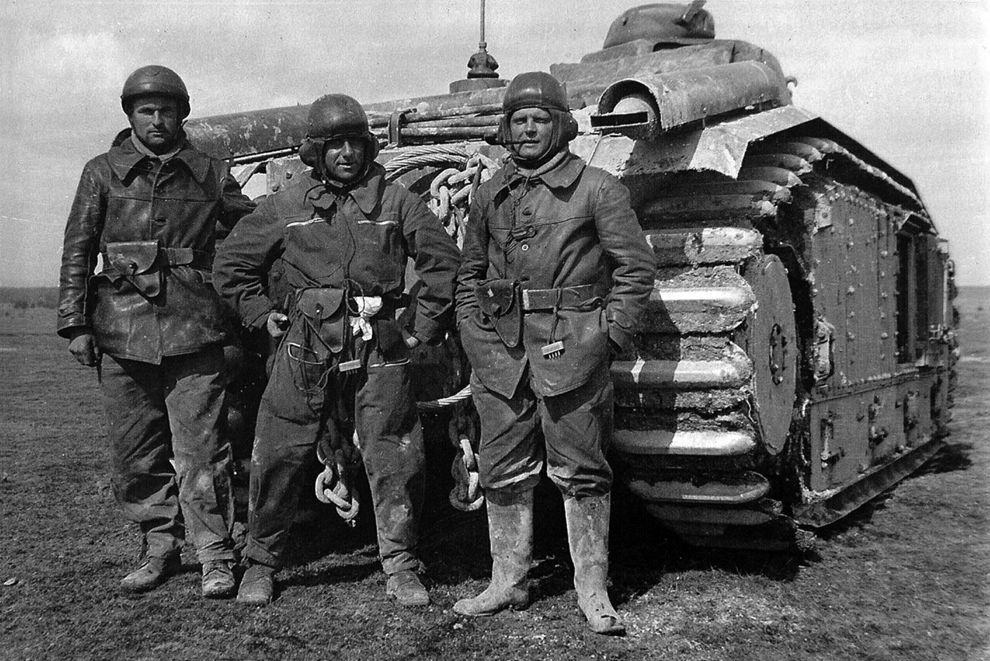 Staff sergeantJacques Dumas (with pipe, KIA June 15, 1940) poses with his crew in front of their Char B1 heavy tank, originally conceived as a self-propelled gun with a 75 mm howitzer in the hull. Among the most powerfull tanks of its day, the Char1 was very effective in battle with German armor in 1940 but slow speed and high fuel consumption made it ill-adapted to the war of movement then being fought. Some Char1s captured by the Germans were used as mechanized artillery.