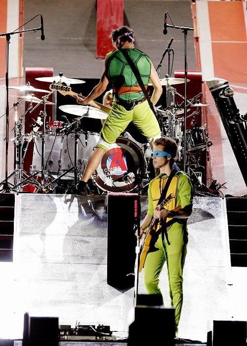 Calum Hood and Luke Hemmings performing onstage at the Sun Life Stadium in Miami, Florida - October 5