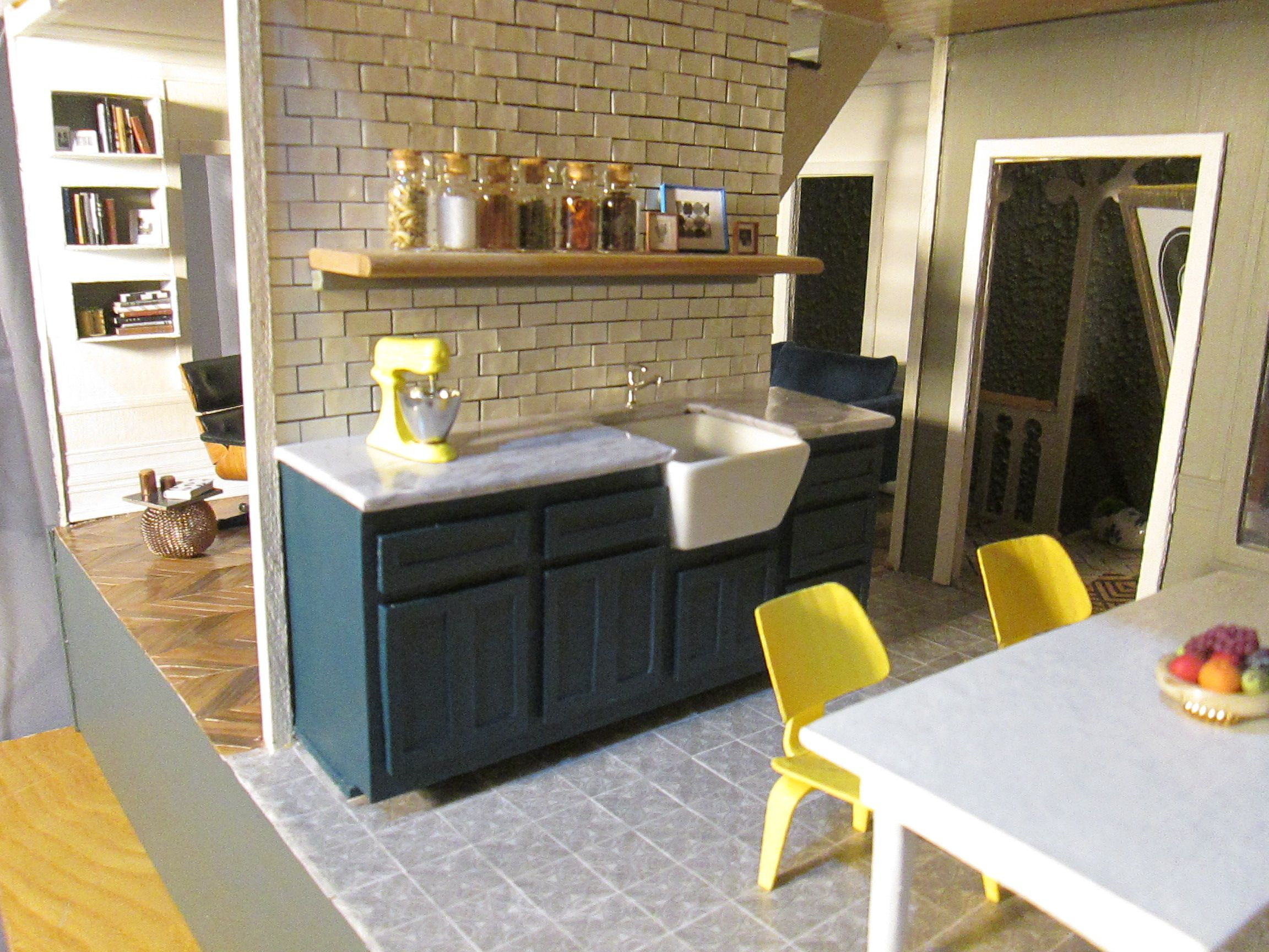 Miniature Dollhouse Kitchen With Navy Shaker Cabinets Farmhouse Sink Subway Tile And Open Shelving Miniature Kitchen Dollhouse Kitchen Kitchen Dining