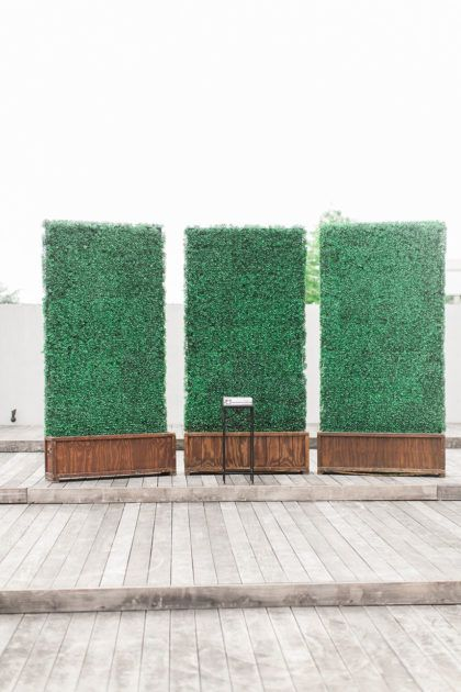 a green grass wall makes a gorgeous backdrop to say i do in front of