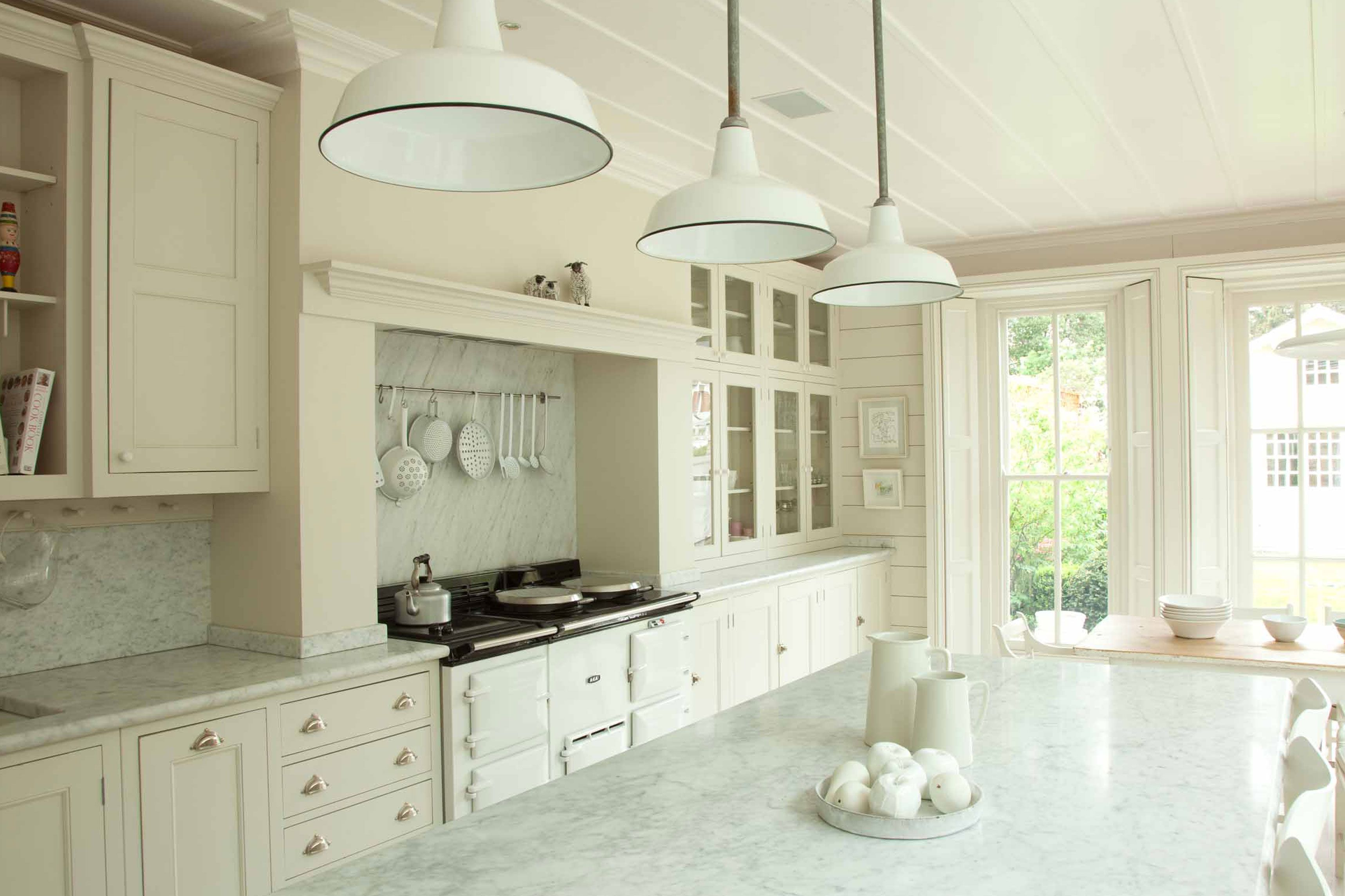 marble counter and backsplash, hooks under cabinets, some open, some ...