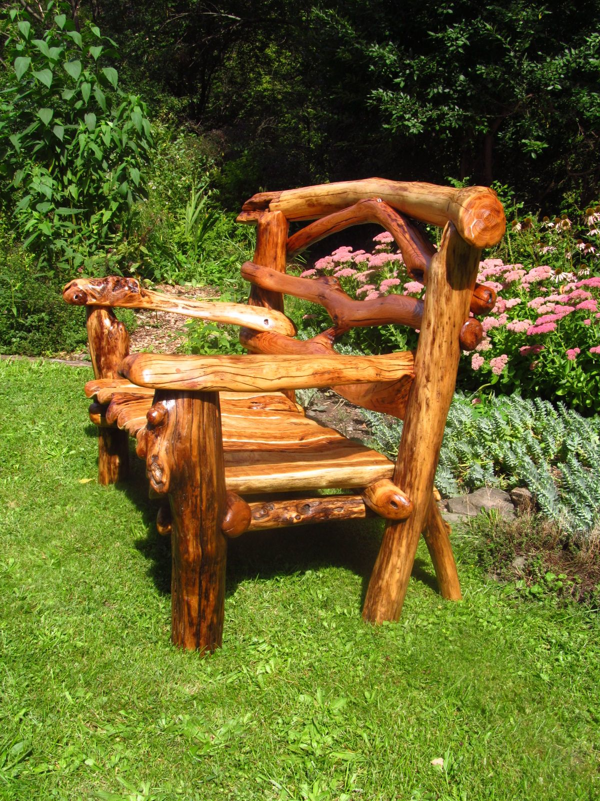Split limb Black Locust bench can stay outdoors due to the high