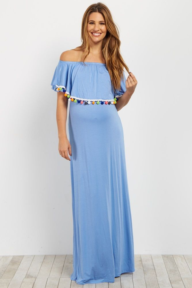 878581a6cb6f6 This maternity dress features a unique pom trim off shoulder neckline that  gives this maxi dress a fun, resort style feel.