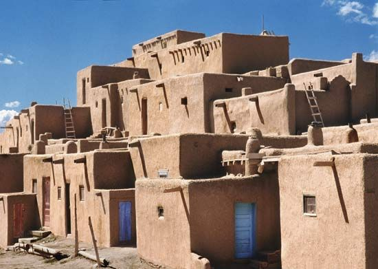 Photograph the apartment style adobe buildings of taos for Adobe construction pueblo co