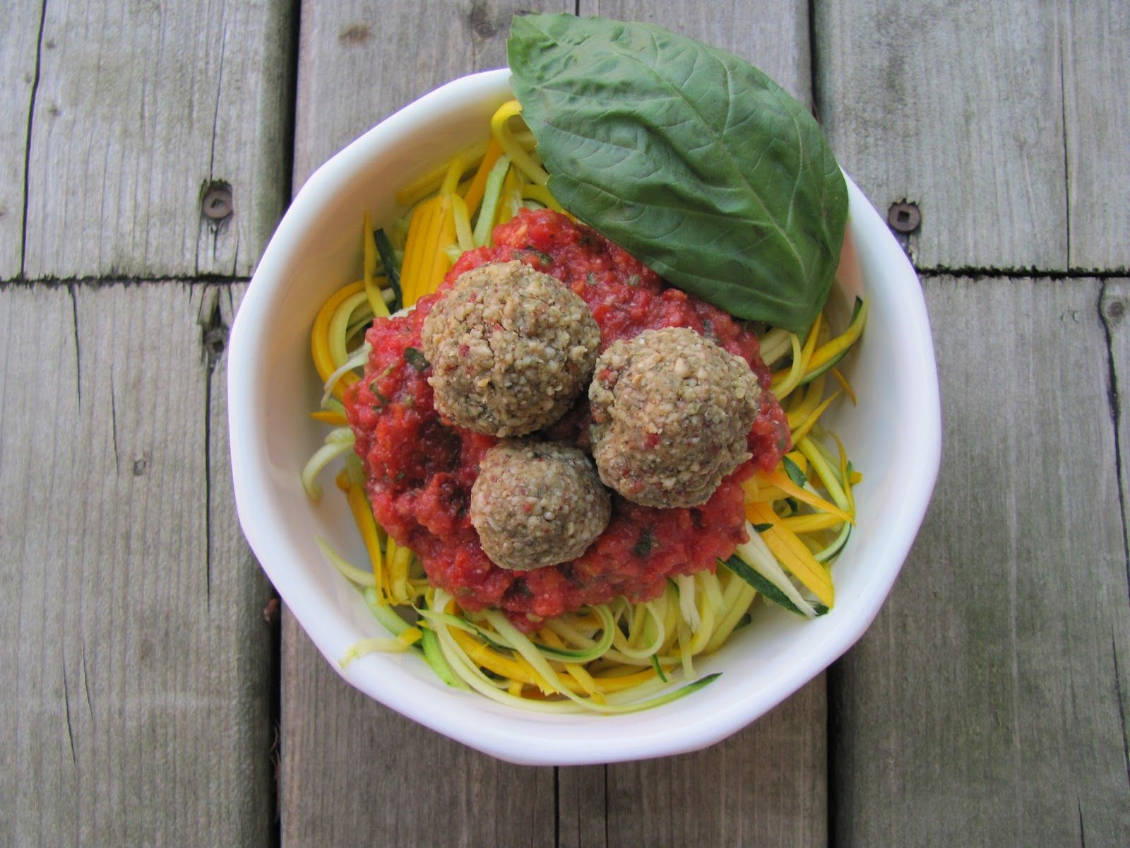 Savoury RAW No-Meat-Balls    Ingredients  1 C raw sunflower seeds  ½ C + 1 T raw almond butter  4 sundried tomatoes, soaked and chopped  3 T fresh basil, shredded  1 T nutritional yeast  1 clove of garlic  1 tsp dried thyme   1 tsp dried oregano  1 tsp olive oil  Pinch cumin  sea salt to taste