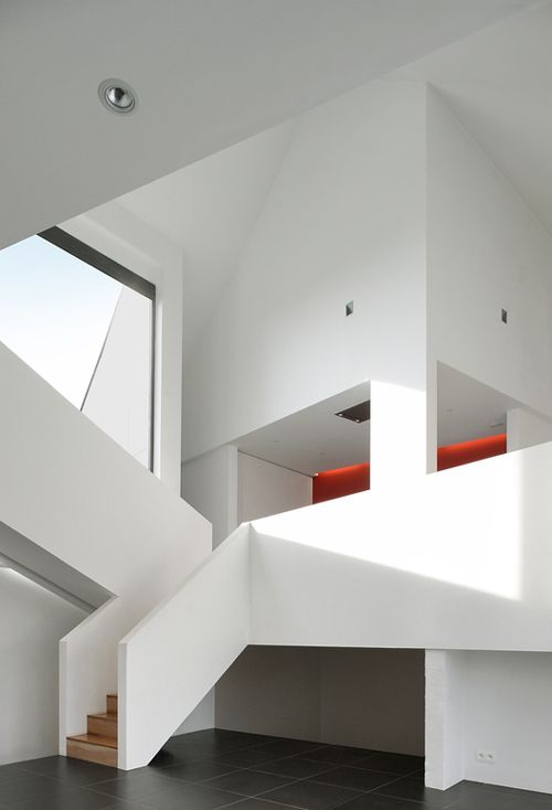 A bit stark perhaps but nice forms in this domestic house in Belgium ...