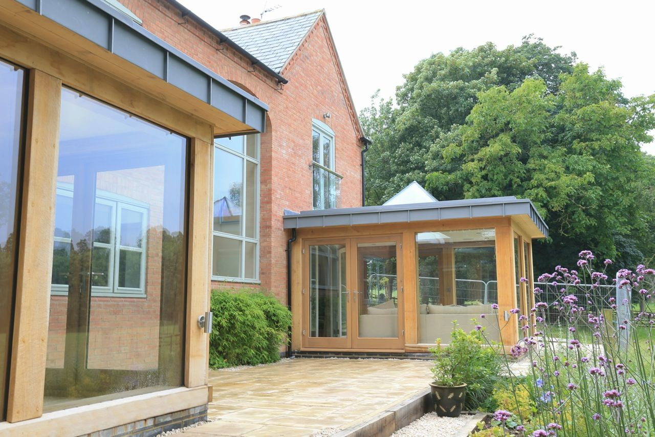 Contemporary oak frame design in alexton extensions Contemporary flat roof designs