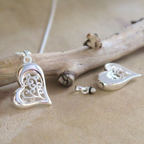"""NEW """"Our Hearts Meet"""" memorial pendant ... a very precious way to keep a loved one close to your heart.  Crafted to hold a lock of hair, burial soil or some cremation ashes safely and discreetly inside."""