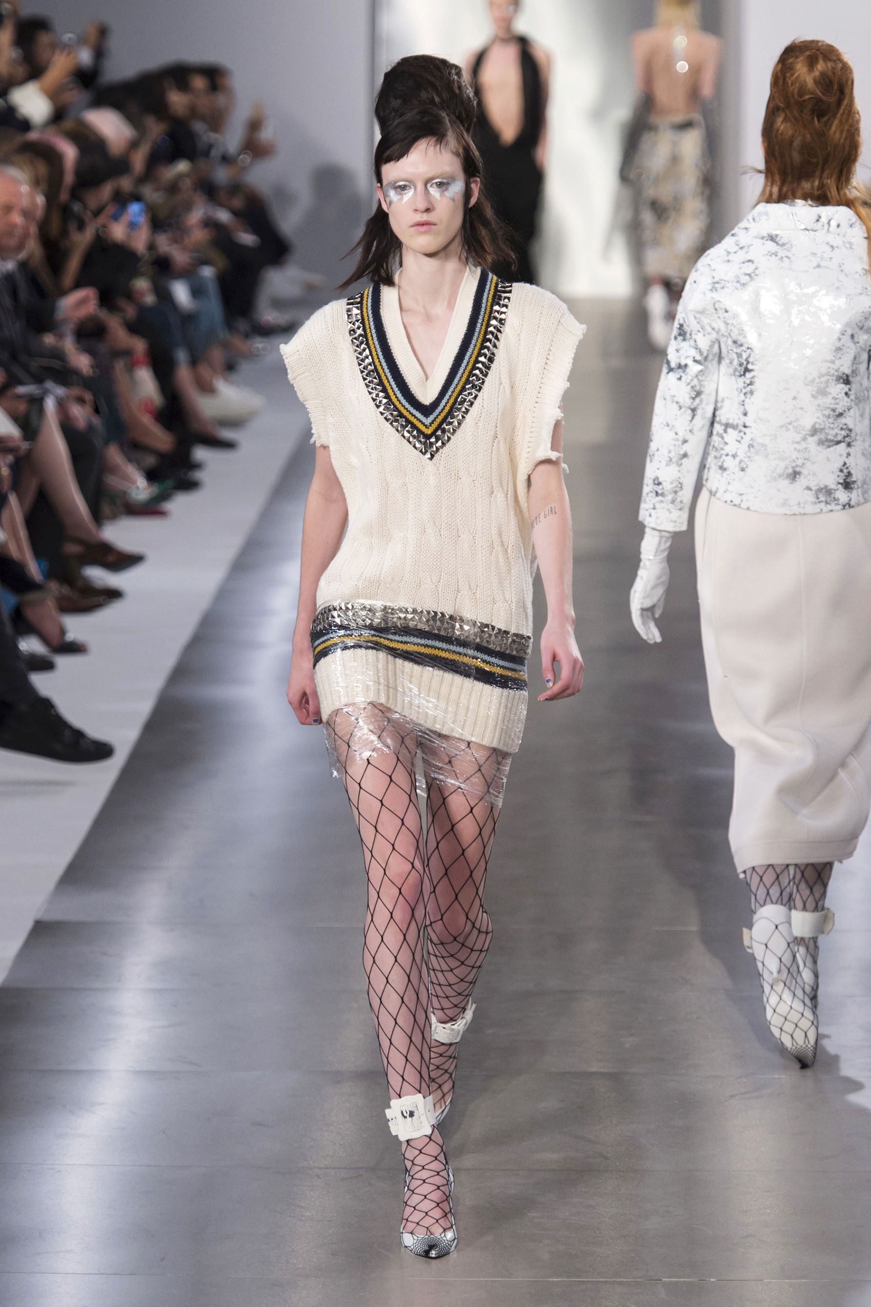 He smartly reworked traditional ideas, like the tennis sweater stripes done in metal grommets or embellishments on skirts and coats that looked like crystal eyelashes.    - HarpersBAZAAR.com
