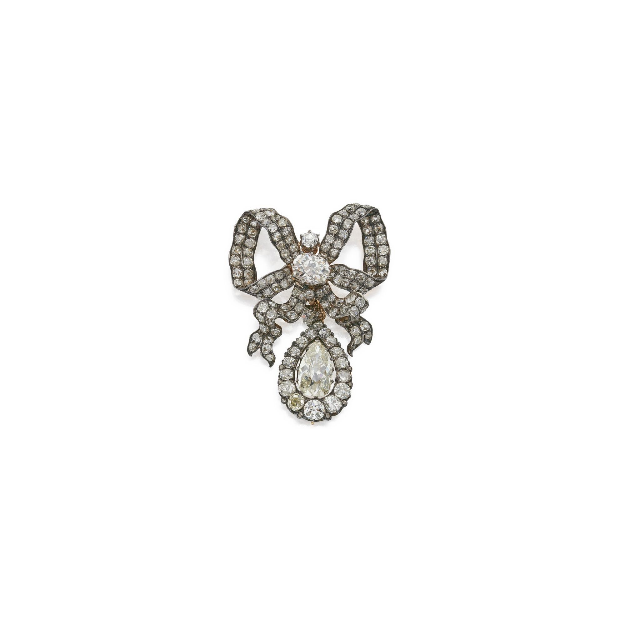 Diamond pendantbrooch the center of the bow set with a carat