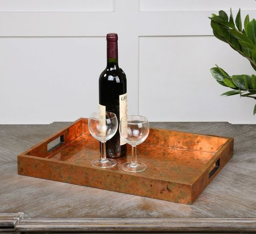 """Use a tray such as our """"Artesana"""" Copper Tray to bring your guests water, snacks or as a place to hold their personal items."""