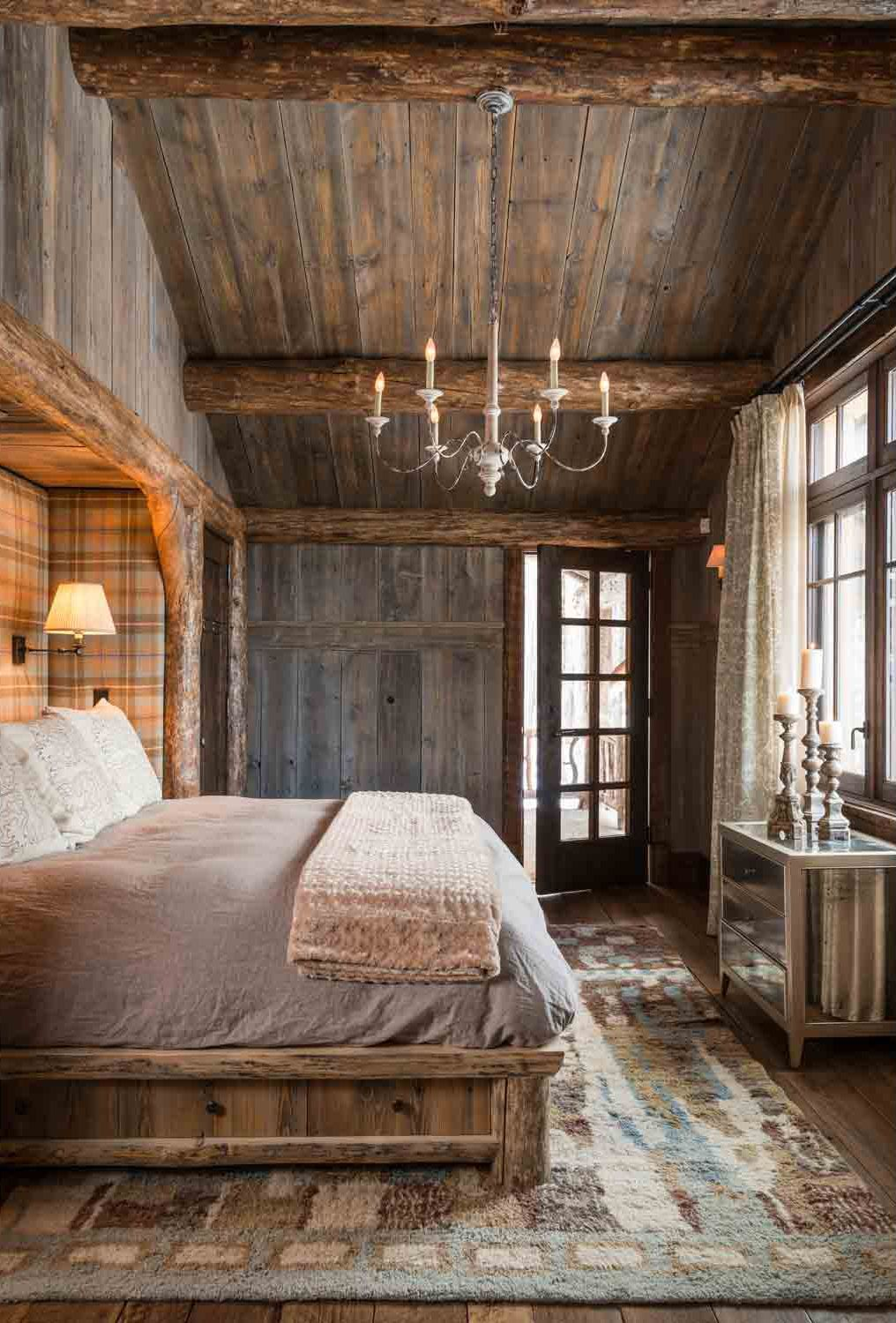 cabin/mountain home master bedroom with chandelier and tartan full ...