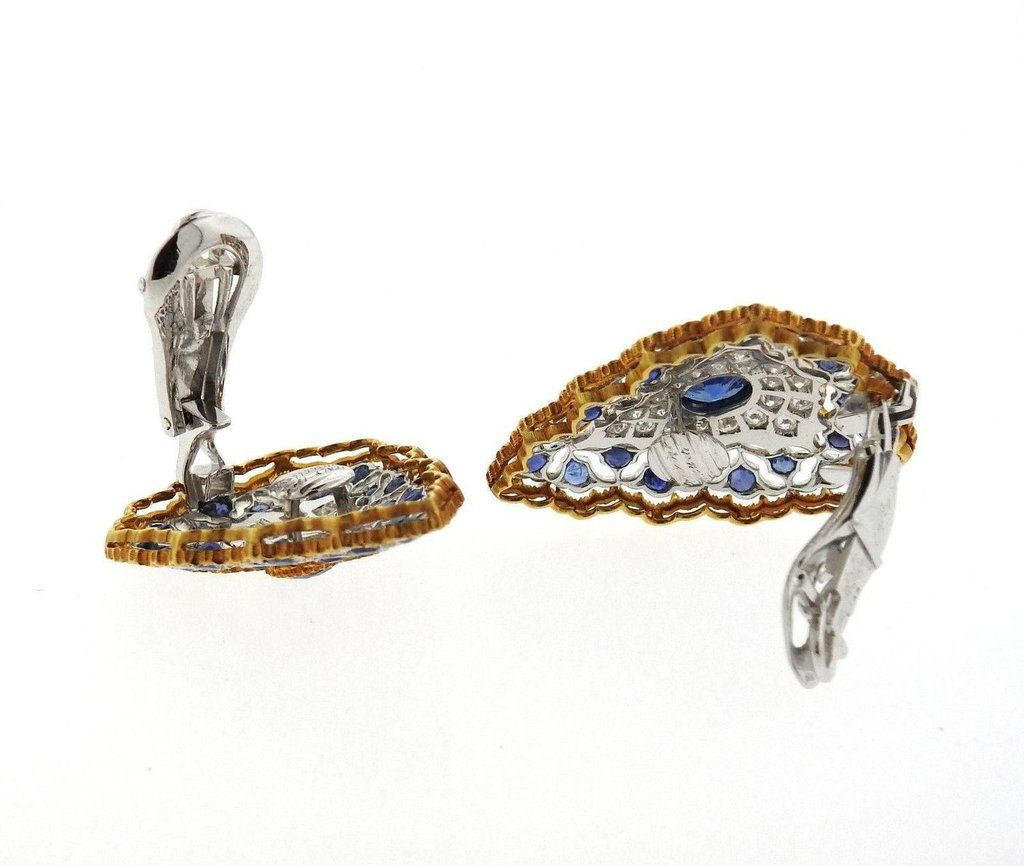 A pair of 18k yellow and white gold earrings set with sapphires and approximately 1 carat of GH/VS diamonds. The earrings measure 35mm x 25mm and weigh 17.2 grams. Marked: Buccellati, Italy, 18k.                                                                                    DESIGNER:Buccellati   MATERIAL: 18k Gold  GEMSTONE: ...