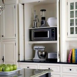 Hideaway rolling cabinet door for appliances like the microwave ...