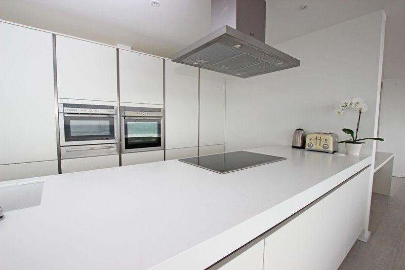 Matt White Handleless Kitchen With Glacier White Corian