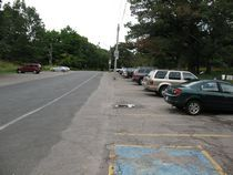 Parking in High Park, Toronto.  Image 1 of 6.  Toronto paves over acres of parkland for parking lots and roads to encourage people to drive their cars into the park, yet bans electric bicycles.  Hypocrisy.