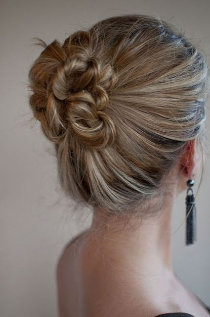 I love making this bun when my hair is one day dirty. Make a high or low side pony with a rubber hair tie. Pull some hair loose to give a messy look. Pull small sections of hair and roll them under like a curl all the way to your head then pin with a bobby pin. Try to pin them next to eachother to hide the pins, messy is ok. Spray lightly with hairspray. Love it for summer!