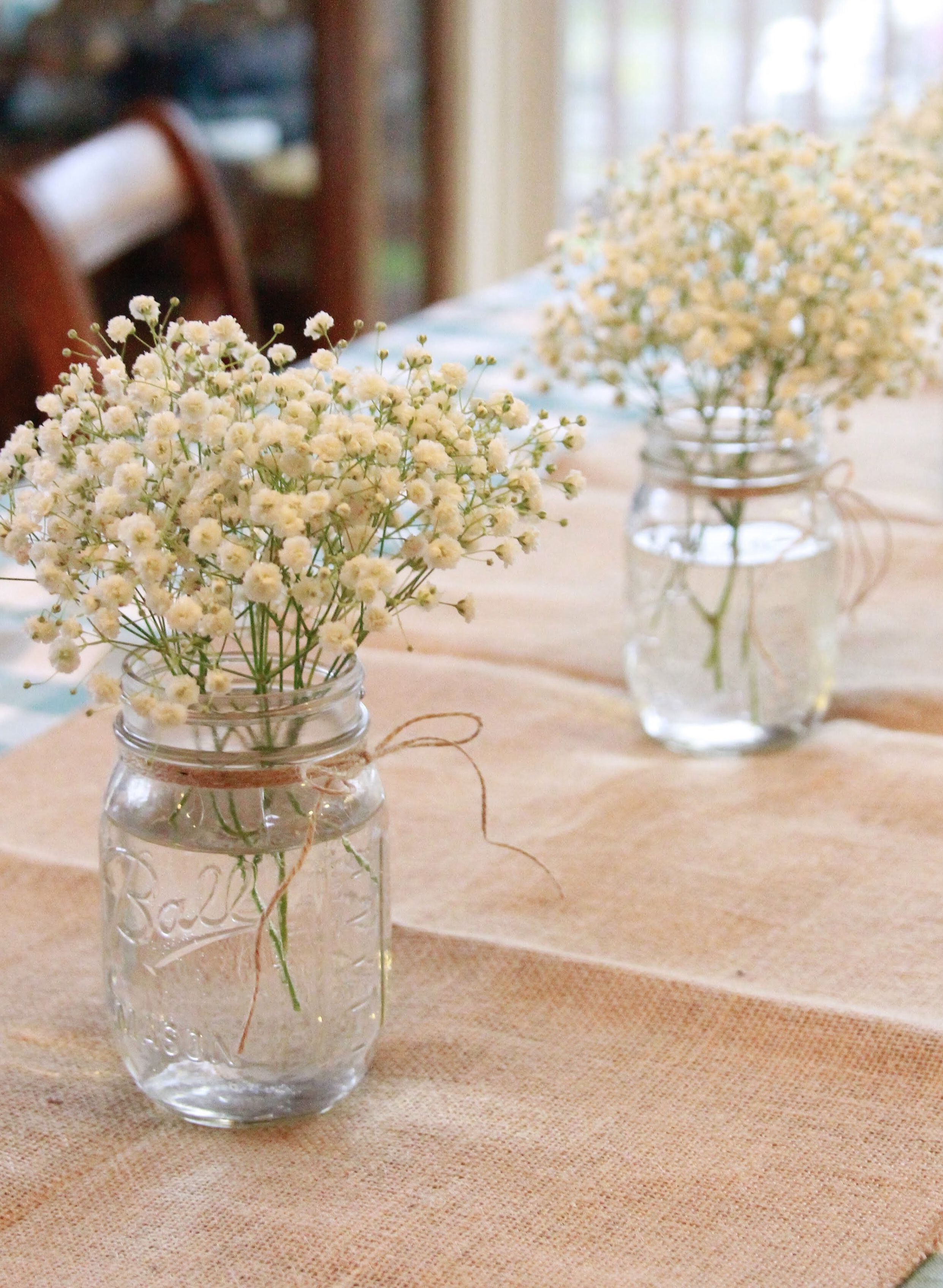 Baby S Breath In Mason Jars As Centerpiece Decorations For Rustic Cowgirl First Birthday Part Rustic Birthday Parties Boho Birthday Party Floral Birthday Party
