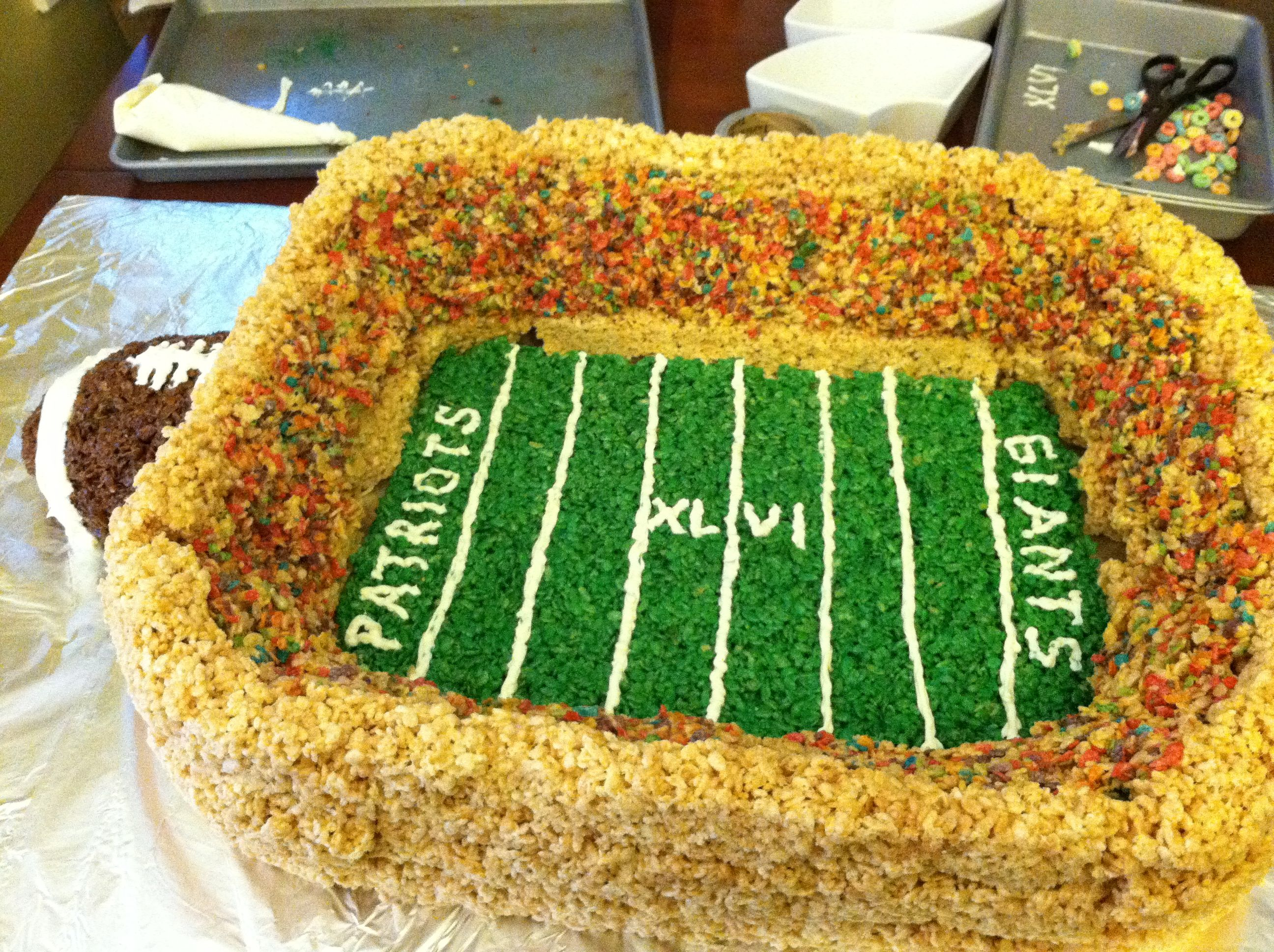 Rice krispie treats football stadium includes green food coloring fruity pebbles and cocoa krispies the white lines are icing so easy