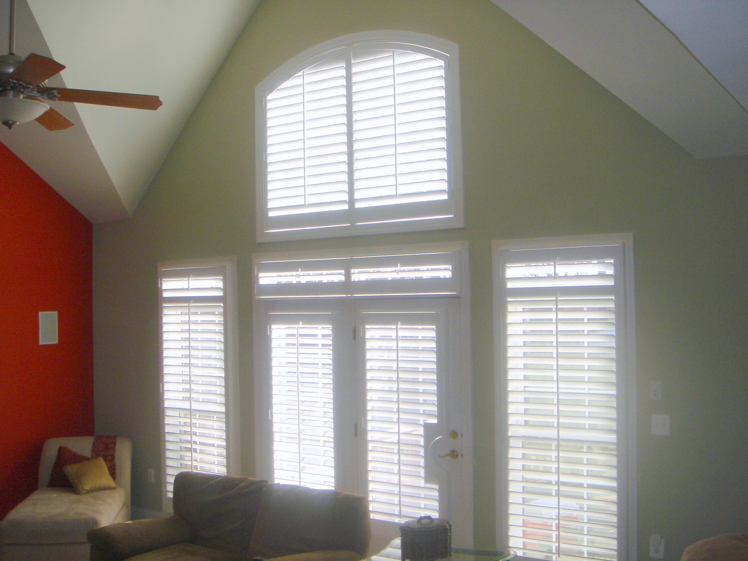 Arch French Doors And Windows With Transoms All Covered With Interior Plantation Shutters