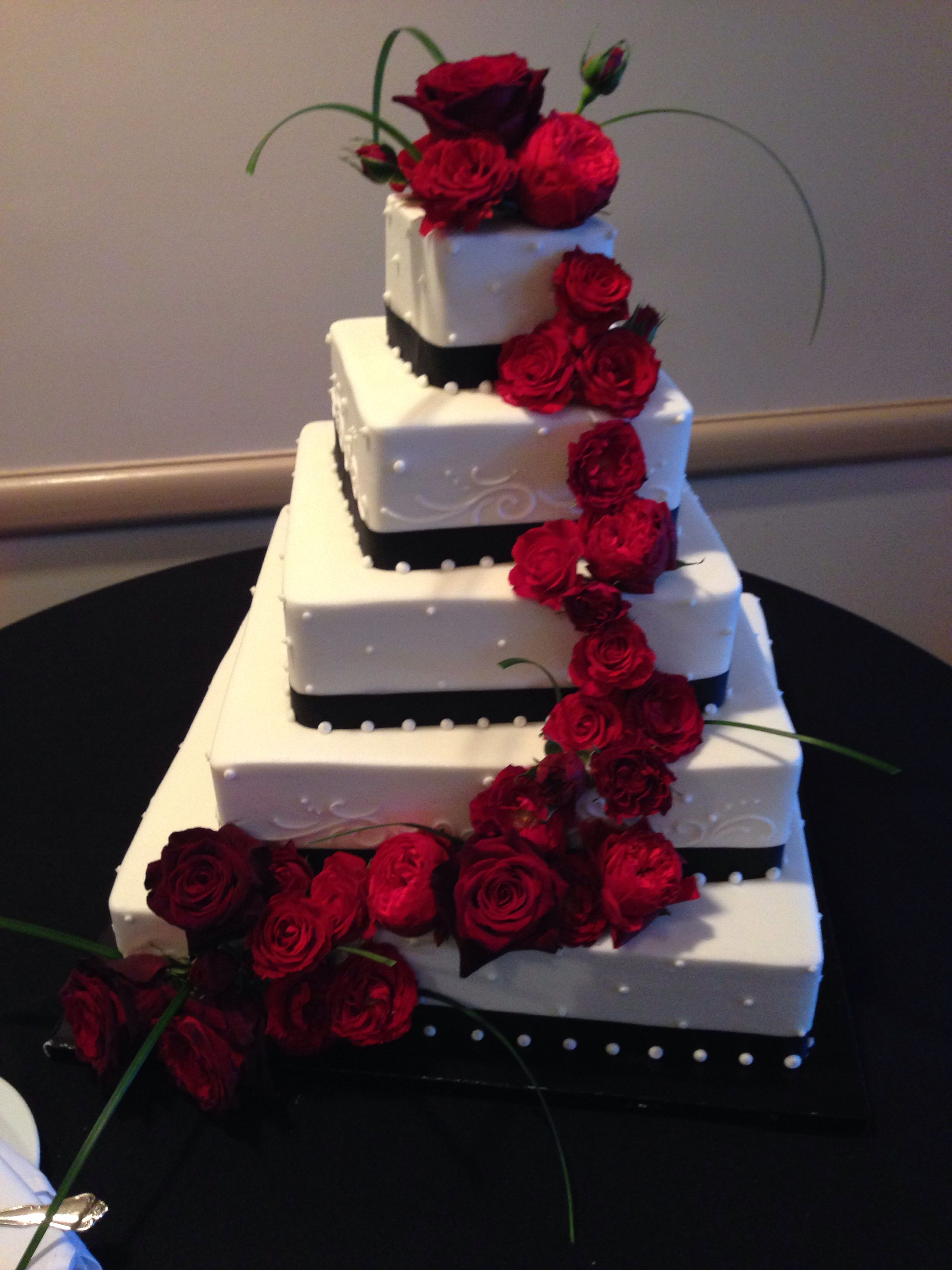 Black white wedding cake with red roses