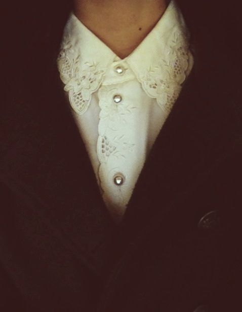 vintage - white lace, pearl buttons on white shirt, black v-neck sweater