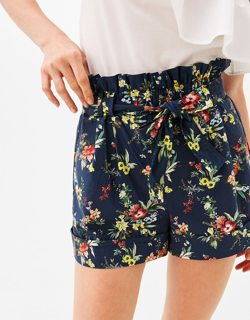 300a8cd7f Poplin bermuda shorts with belt and a floral print. Discover this and many  more items in Bershka with new products every week