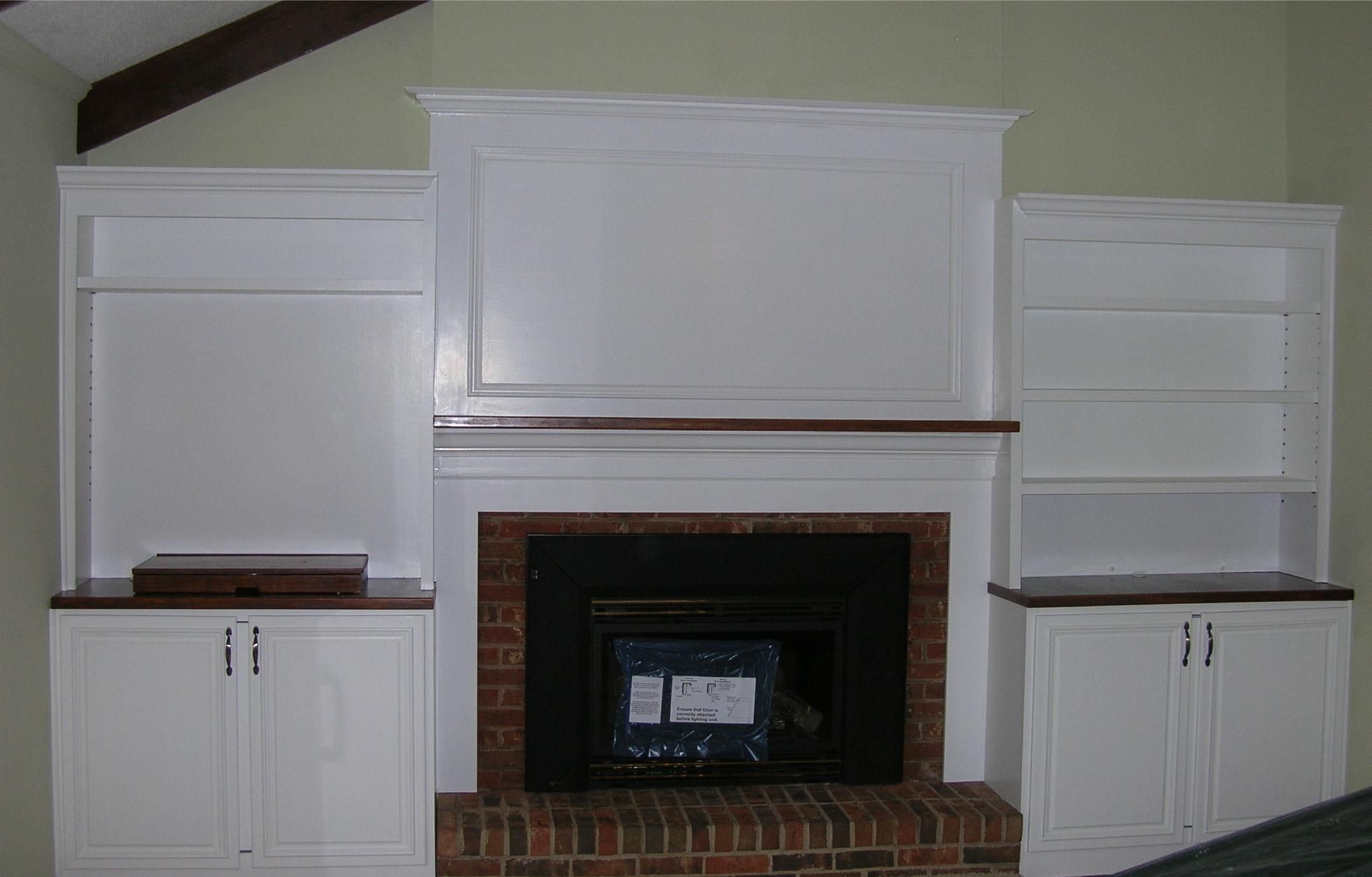 Built in bookcase with fireplace surrounding the for Media center with bookshelves