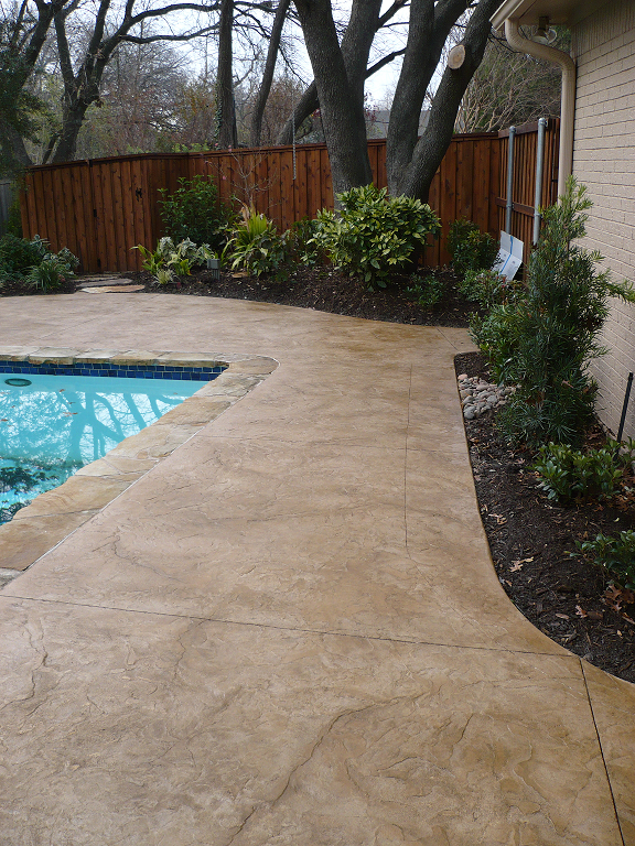 Stamped concrete pool decks photos stamped concrete pool for Concrete pool patio ideas