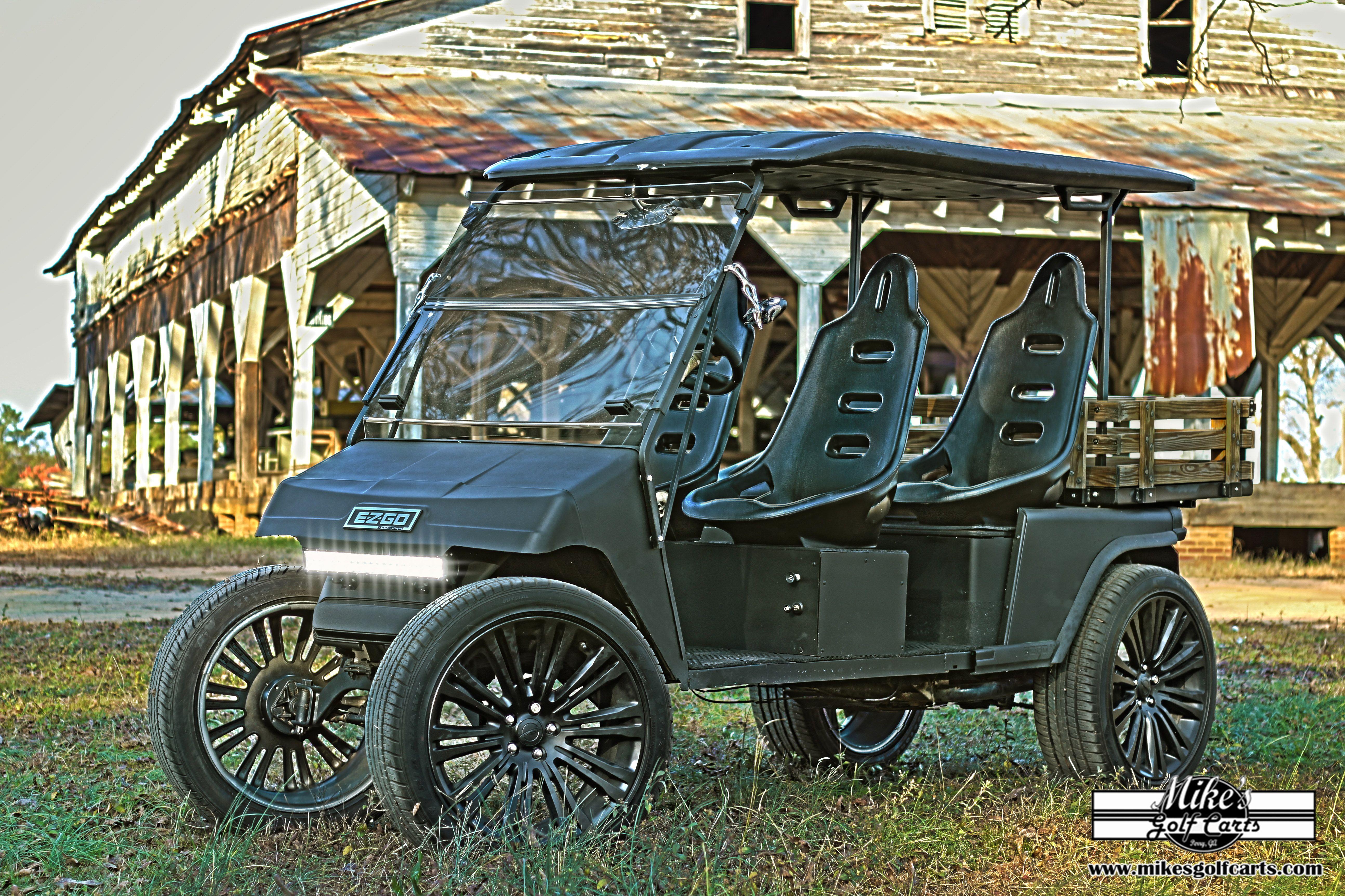 Our Custom Ez Go Golf Cart Stretch Matte Black Four Seater Sitting On 20 S Ezgo Golf Cart Golf Carts Custom Golf Carts