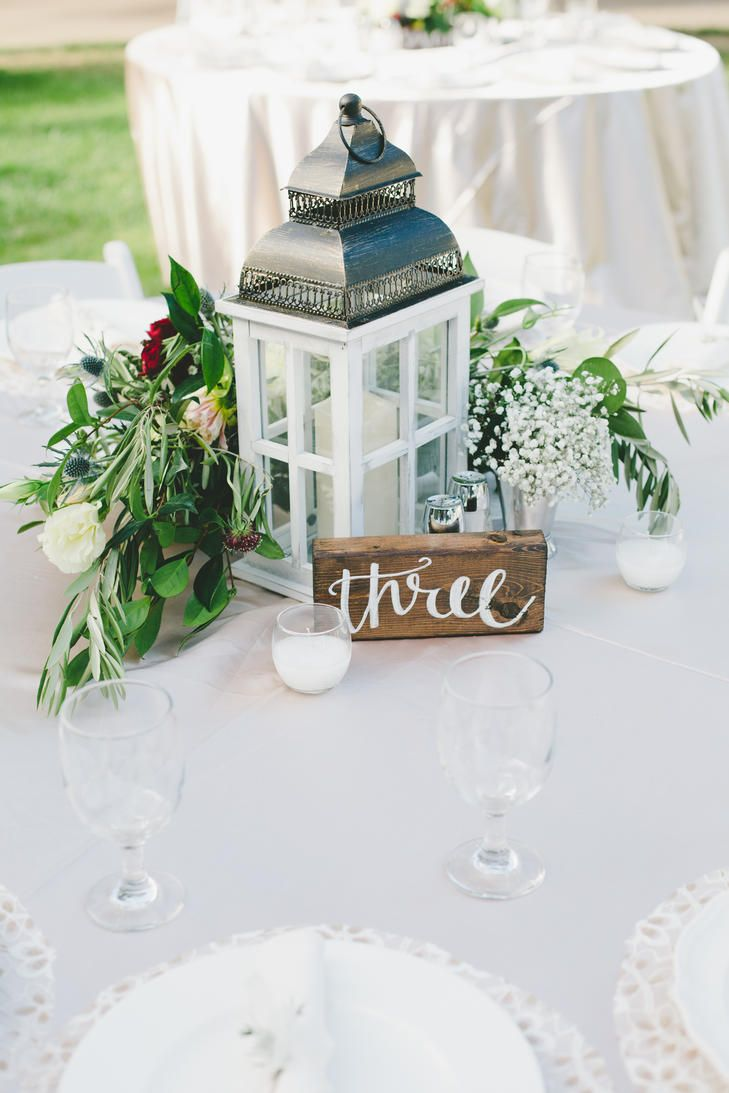 Wedding reception centerpieces of a lantern floral and