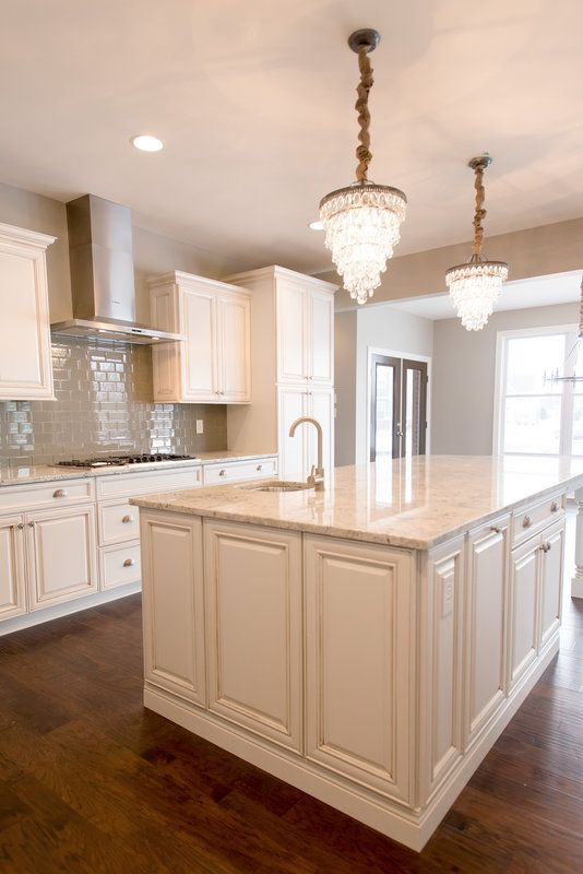 Beautiful White Kitchen With Dark Hand Scraped Hardwood Floors - Wayfair kitchen cabinets