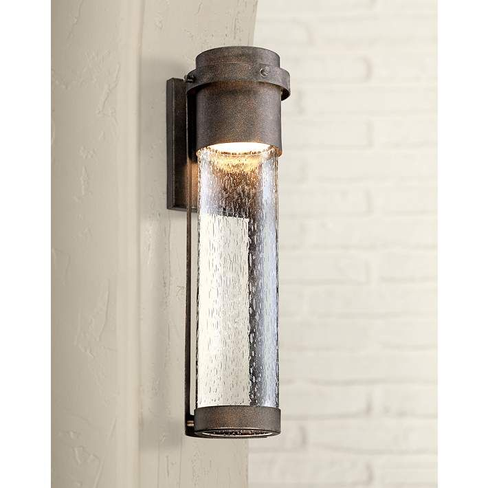Brighten your homes exterior with this smart energy efficient led outdoor lighting fixture the handsome design features a clear seedy glass cylinder