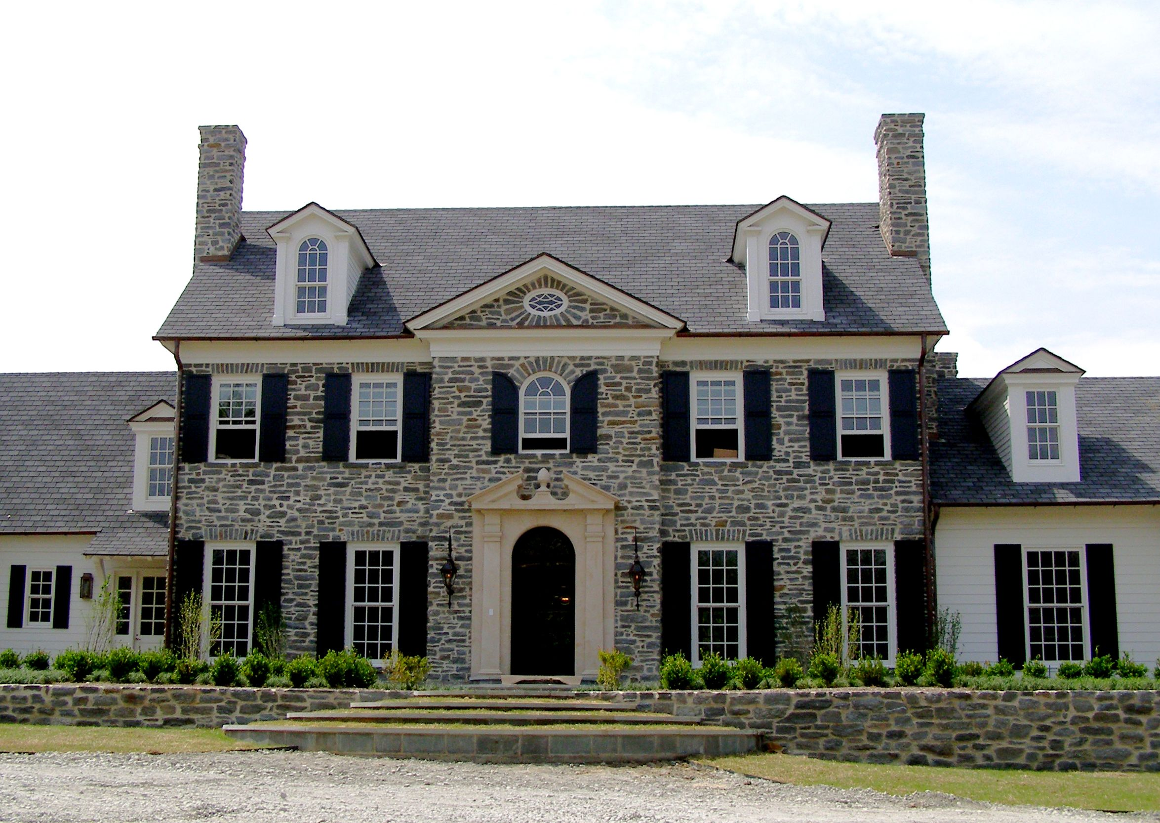 Front Entry Stone Facade Of An American Style Home: houses with stone facade
