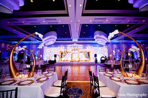 indian wedding reception decor blue gold lighting http