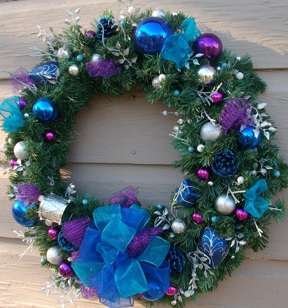 Blue And Silver Ornaments On An Artificial Wreath