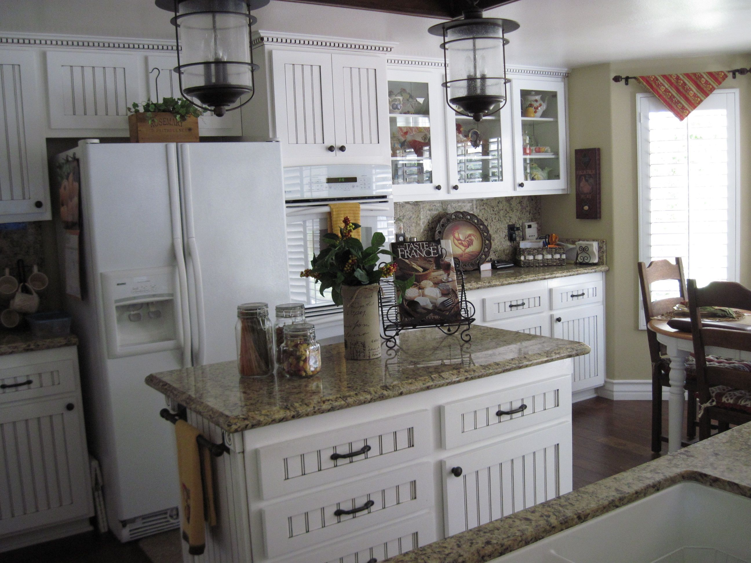 My french country kitchen the cabinets and trim the light fixtures